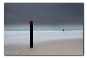 Strandpaal op het strand bij  Ouddorp